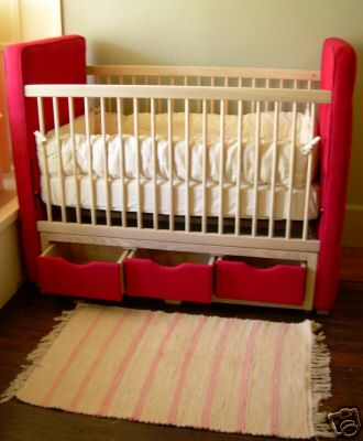 A red Amish made cot