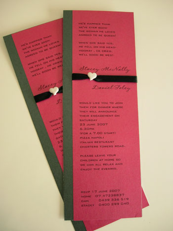 Heart button on red wedding invites from Paperbean Design