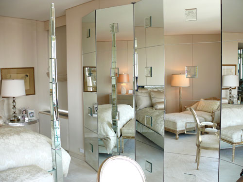 Nancy Corzine's bedroom with large mirrored folding screen