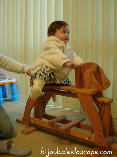 My Hannah on my husband's old rocking horse