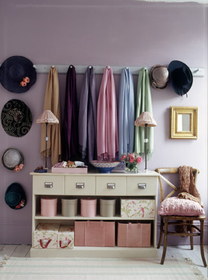 Foyer in a purple space with sideboard