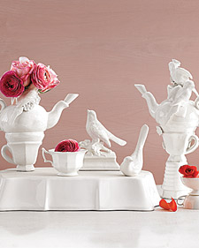 White china grouped as centrepiece with pink roses