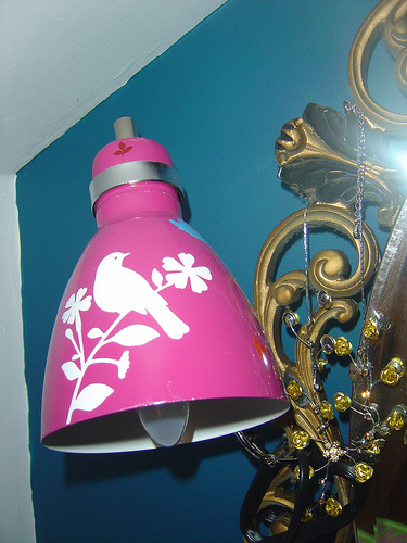 Pink lamp stenciled with bird