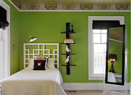 A green, black and white bedroom by Ghislaine Viñas