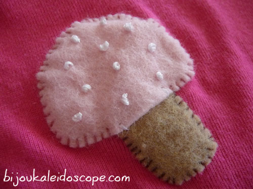 The gorgeous appliqued mushroom on the deep pink T-shirt Hannah got in her party bag