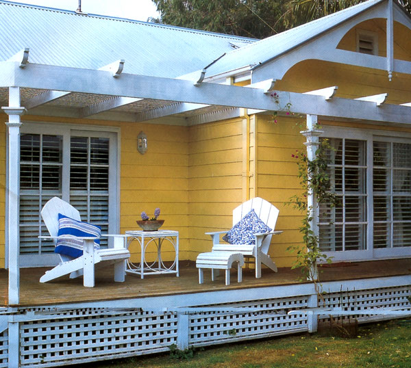 A yellow house with white trim and roof, via Country Home Ideas