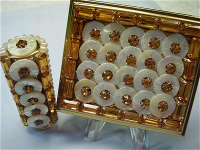 A vintage mother of pearl and gold compact and lipstick set