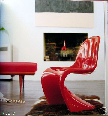 Red Panton chair creates a hint of cheekiness to this living room