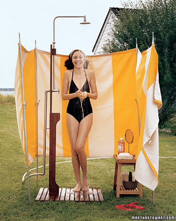 A happy yellow and white outdoor shower, via Martha Stewart