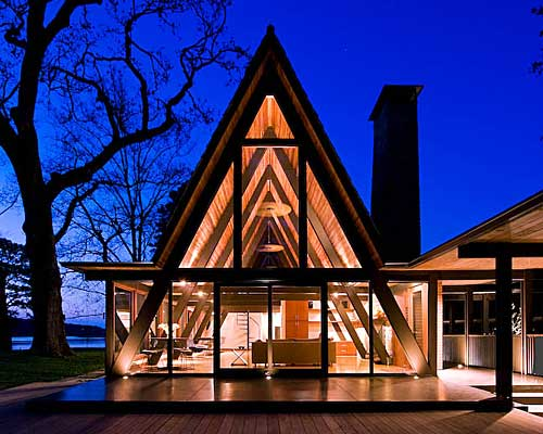 The most beautiful a-frame house lit up at night