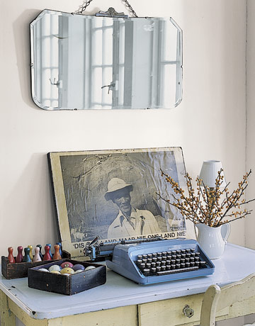 Vintage blue typewriter with etched mirror above
