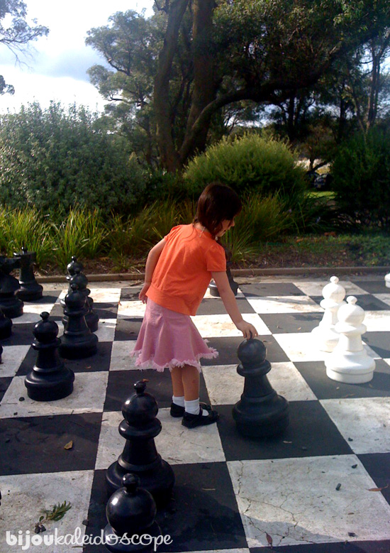 Hannah playing giant chess with the grandfather